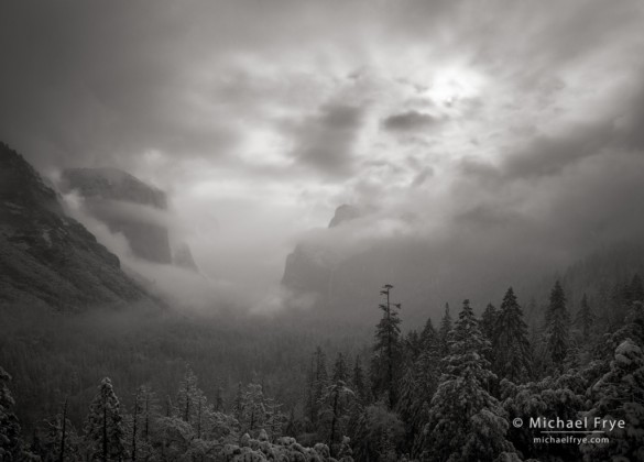 Sun breaking through mist after a spring snowstorm, Tunnel View, Yosemite NP, CA, USA