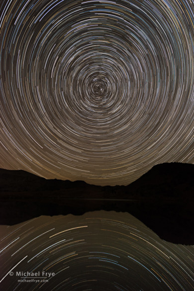 Star trails reflected in an alpine lake, Yosemite NP, CA, USA. Nikon D800e with 17-35mm f/2.8 lens; sequence of 24 exposures totaling about 96 minutes; each exposure 4 minutes at f/5.6, 400 ISO