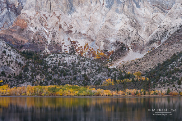 Rock formations and autumn color along the base of Laurel Mountain from Convict Lake, Inyo NF, CA, USA