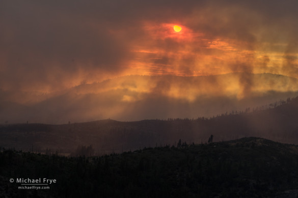 Sun setting through smoke from the El Portal Fire, 7/28/14, Yosemite NP and Stanislaus NF, CA, USA