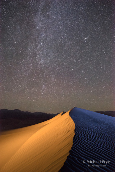 Milky Way and Andromeda Galaxy over sand dunes, Death Valley NP, CA, USA (light-painted)