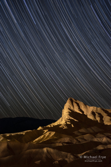 Manly Beacon at night with star trails, Death Valley NP, CA, USA