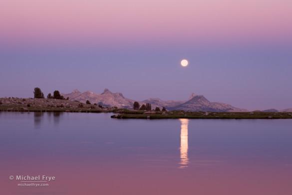 Full moon setting over Middle Gaylor Lake at dawn, Yosemite NP, CA, USA