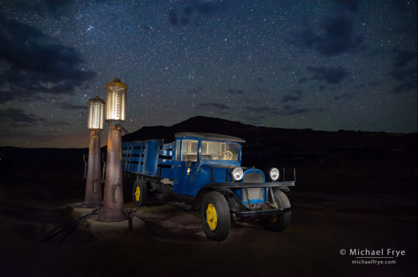 1927 Dodge Graham with gas pumps at night, Bodie State Historic Park, CA, USA