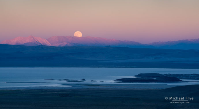 Moon rising above Mono Lake and the White Mountains at sunset, CA, USA