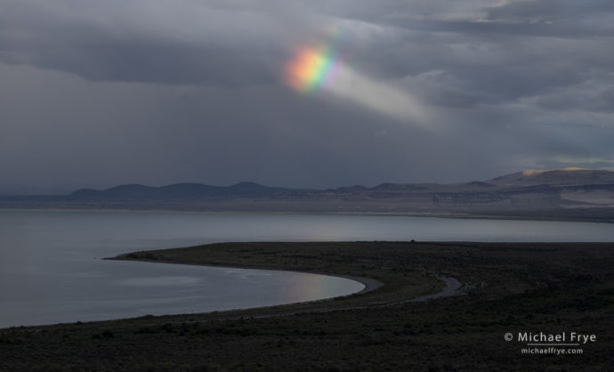 Rainbow and sunbeam over Mono Lake, CA, USA