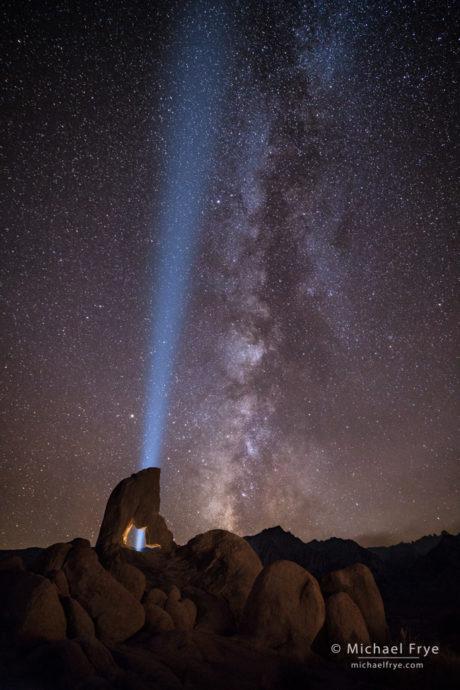 Light beam, Milky Way, and arch, Alabama Hills, CA, USA