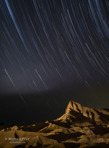 Star trails over Manly Beacon, Death Valley NP, CA, USA