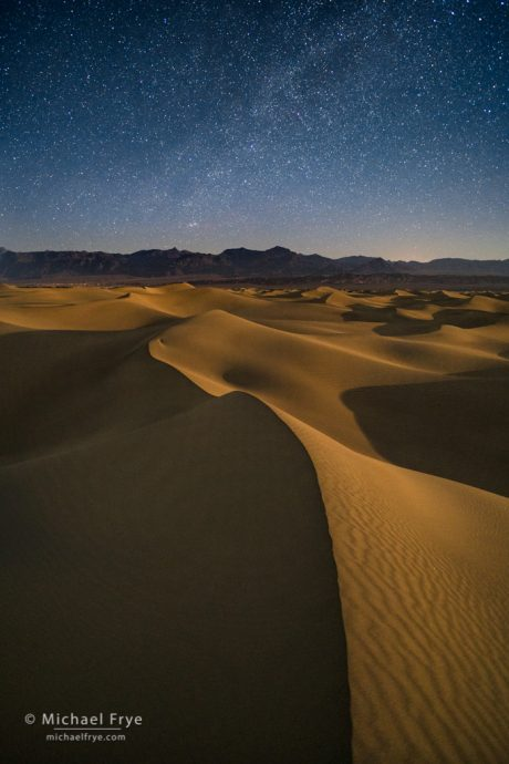 Moonlight on sand dunes underneath the Milky Way, Death Valley NP, CA, USA