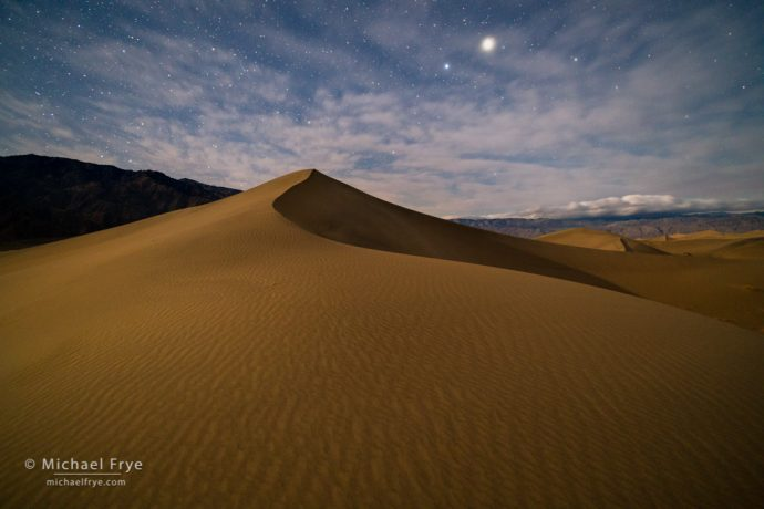 Moonlit sand dune and Jupiter, Death Valley NP, CA, USA