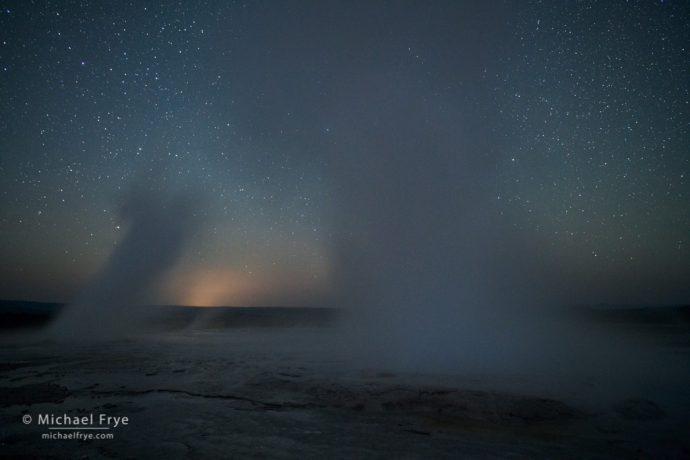 Fountain and Clepsydra Geysers erupting at night, Yellowstone NP, WY, USA