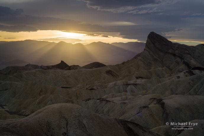 Sun setting behind Manly Beacon, Death Valley NP, CA, USA