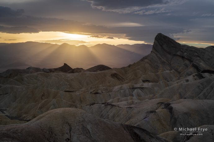 Sun setting behind Manly Beacon, Death Valley, with the Adobe Landscape profile, Adobe Lightroom Classic CC. There's a bit more definition in the clouds near the sun and the sunbeams, plus a little more shadow detail.