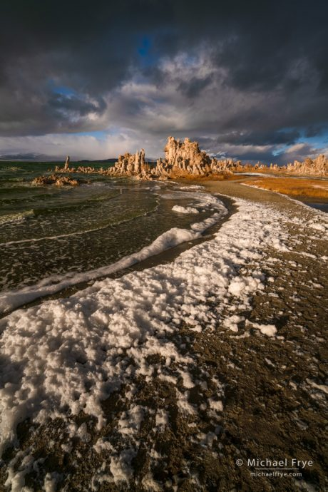 Foam lining the shore of Mono Lake on a stormy afternoon, CA, USA