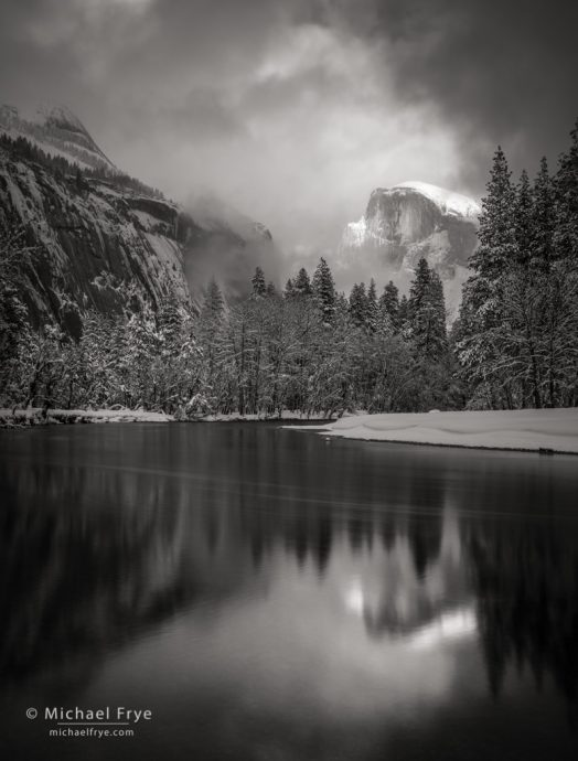 Half Dome, North Dome, and the Merced River with clouds, mist, and snow, Yosemite NP, CA, USA