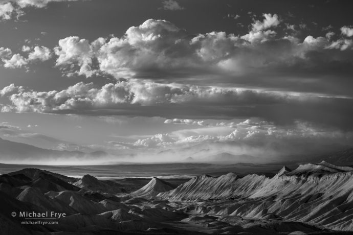 Badlands and a distant sandstorm, Death Valley NP, CA, USA
