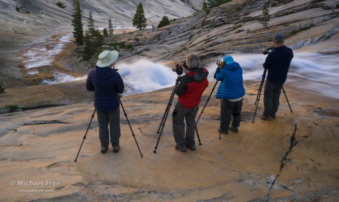 Photographers above a cascade, Yosemite NP, CA, USA