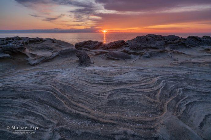 Sunset and sandstone formations, Oregon coast, USA