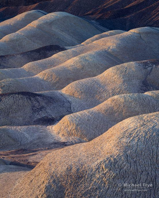 Badland formations, in late-afternoon light, Death Valley NP, CA, USA