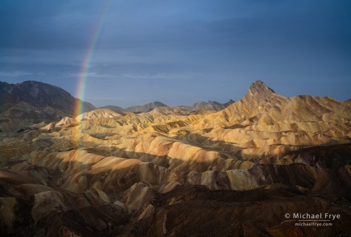 Rainbow over badlands, Death Valley NP, CA, USA