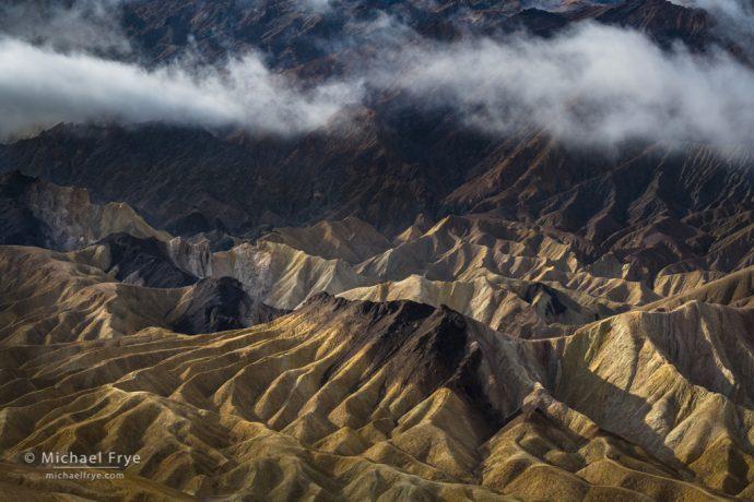 Mist over badlands, Death Valley NP, CA, USA