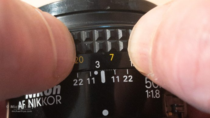 Instead of using foot or meter marks on the lens, you can just mark the closest and furthest points with your fingernails.