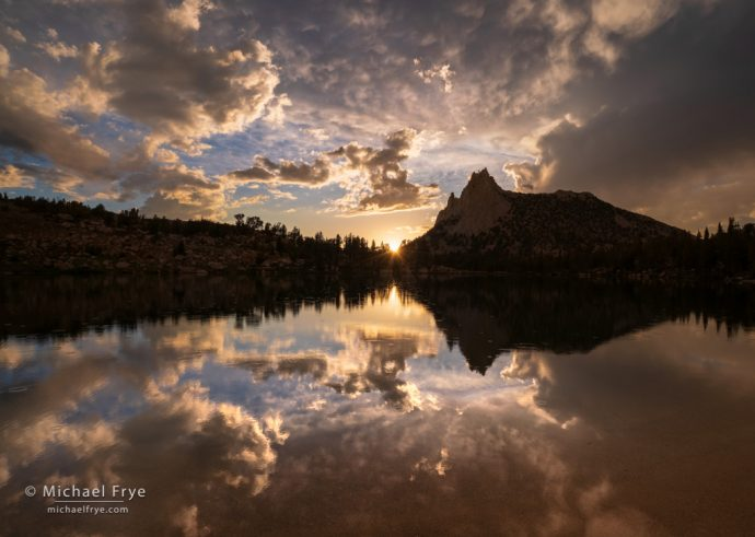 Sun setting over an alpine lake, Yosemite NP, CA, USA