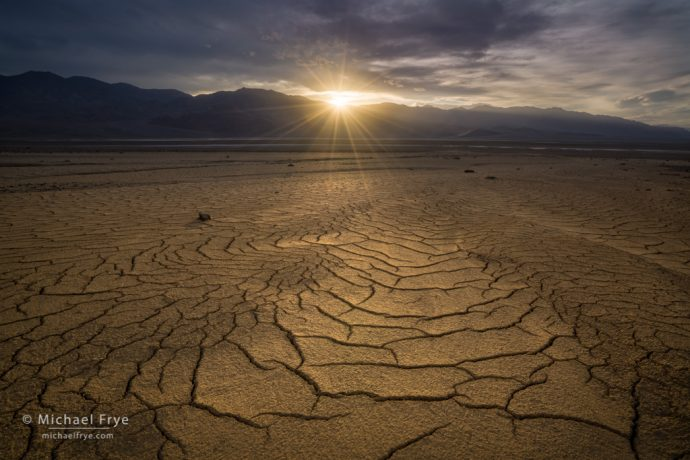 Mud cracks and setting sun, Death Valley NP, CA, USA