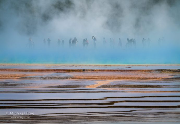 People in the blue mist, Grand Prismatic Spring, Yellowstone NP, WY, USA